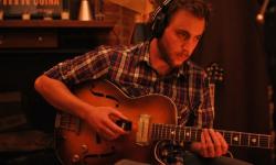 paulbasile-with-guitar